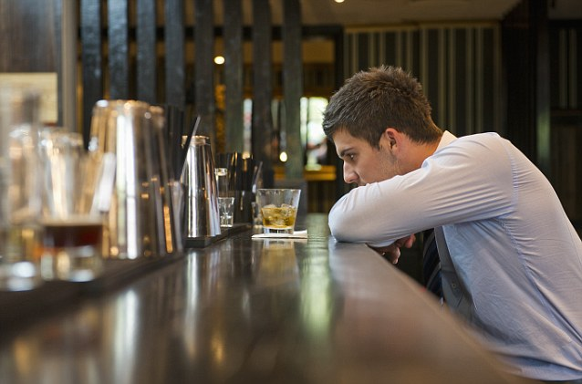 Dejected businessman having drink at bar --- Image by © Les and Dave Jacobs/cultura/Corbis